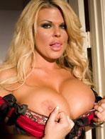 Busty blonde Sophia Rossi in a corset