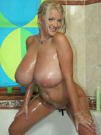 Busty blonde Faith showering