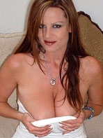 Kelly Madison in a white dress