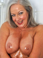 Mature lady with wet tits