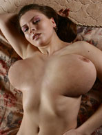 Olga naked on the bed