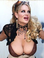 Pics of Kelly Madison taking off her bra