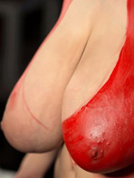 Hitomi Tanaka displays her painted boobs