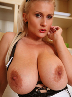 Hot maid Cassandra topless in the kitchen