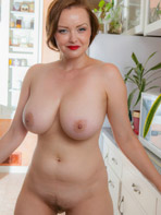 Naked Cosmid model Natasha in the kitchen