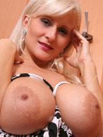 Busty Cassandra stripping