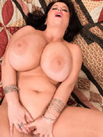Natalie Fiore on the bed