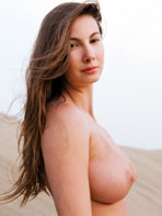 Femjoy model Connie naked on the beach